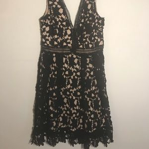 Black lace dress with beige under layer